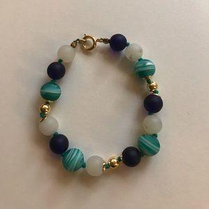 Beaded gold bracelet.